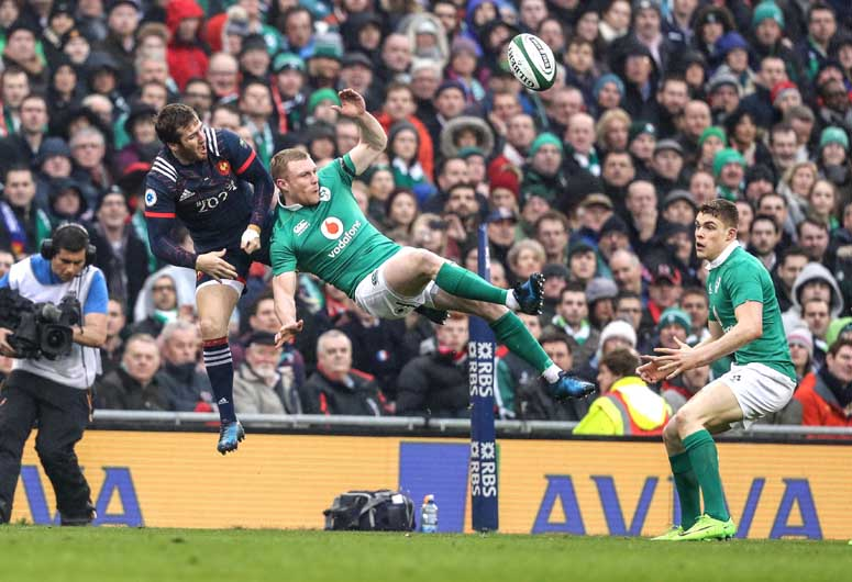 Keith Earls and Camille Lopez in an aerial battle during the France game at the Aviva Stadium.  ©INPHO/Dan Sheridan